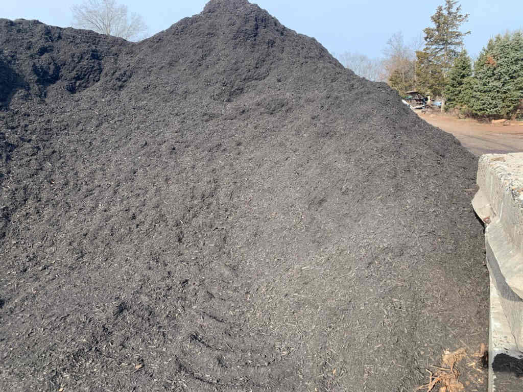 Large pile of black mulch