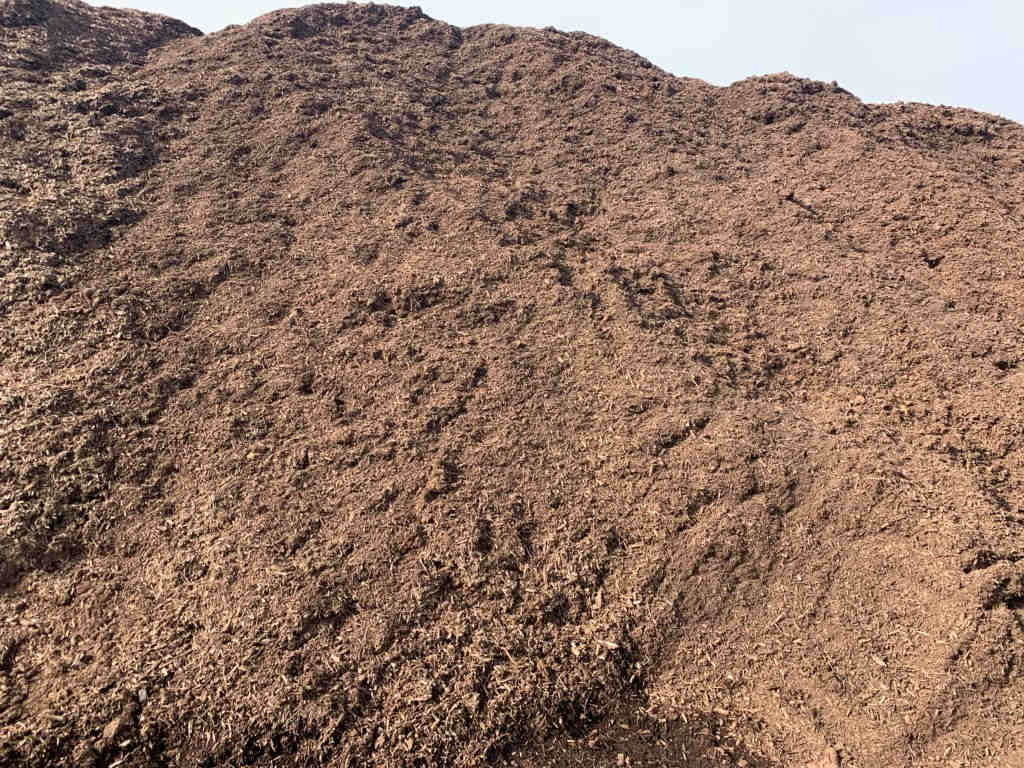 Large pile of brown mulch